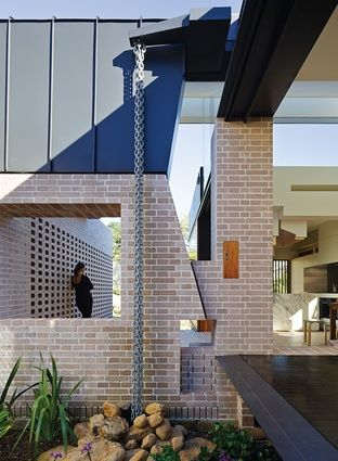 A small eastern courtyard brings light deep into the plan.