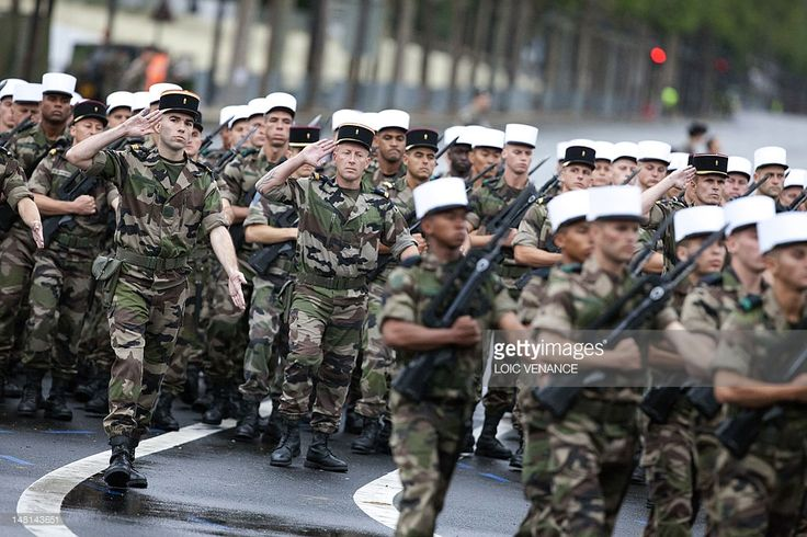 Troops from the French Foreign Legion (Legion etrangere) parade on the Champs Elysees avenue on July 11, 2012 in Paris, during a rehearsal of the military parade as part of the Bastille Day celebrations which will take place on July 14, 2012.