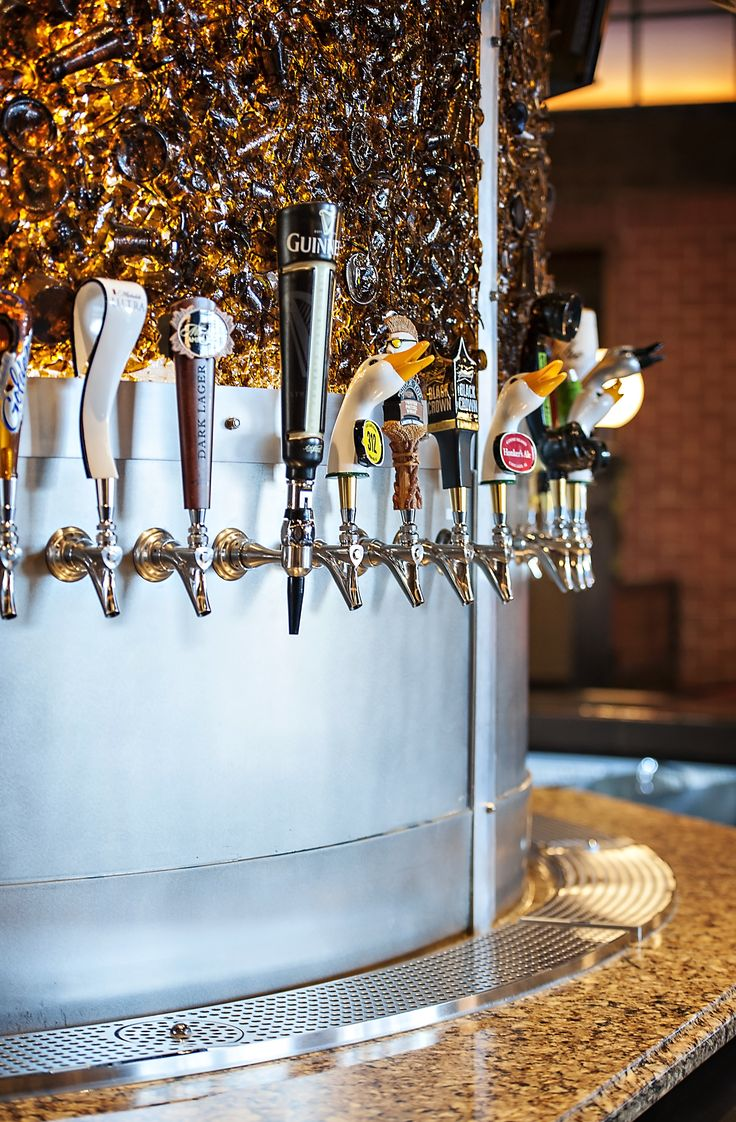 Custom draft beer tower by Micro Matic with stainless steel faucets
