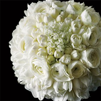 """ircles of white freesias, daffodils, ranunculus, and double tulips form a sleek, sensual bouquet. $350. """"Modern"""" floral design by Paula Arakas, Posy Floral Design, NYC;"""