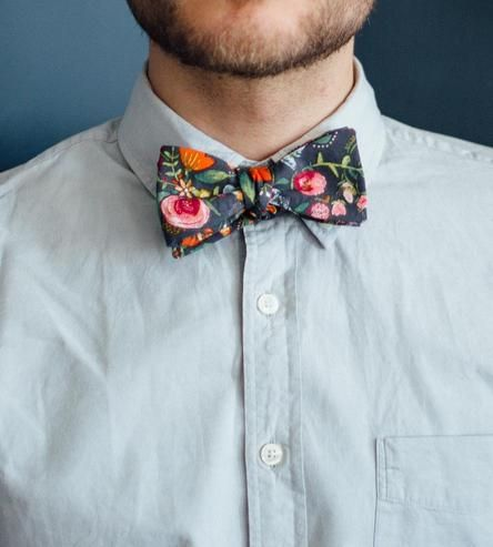 Put your knot-tying skills to good use, and look sharp with this bright little number. Suited for wearing any day of the week, this floral print bow tie adds a dashing finish to any shirt, light or dark. The soft and lightweight cotton fabric features a tropical mix of flowers on a black background for plenty of pop.