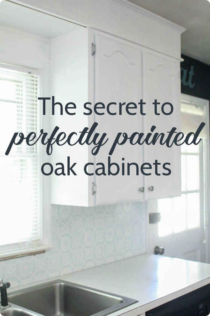 Step by step tutorial for painting oak cabinets white including the best way to get rid of the wood grain. This is one of the best ways to update kitchen cabinets!                                                                                                                                                                                 More