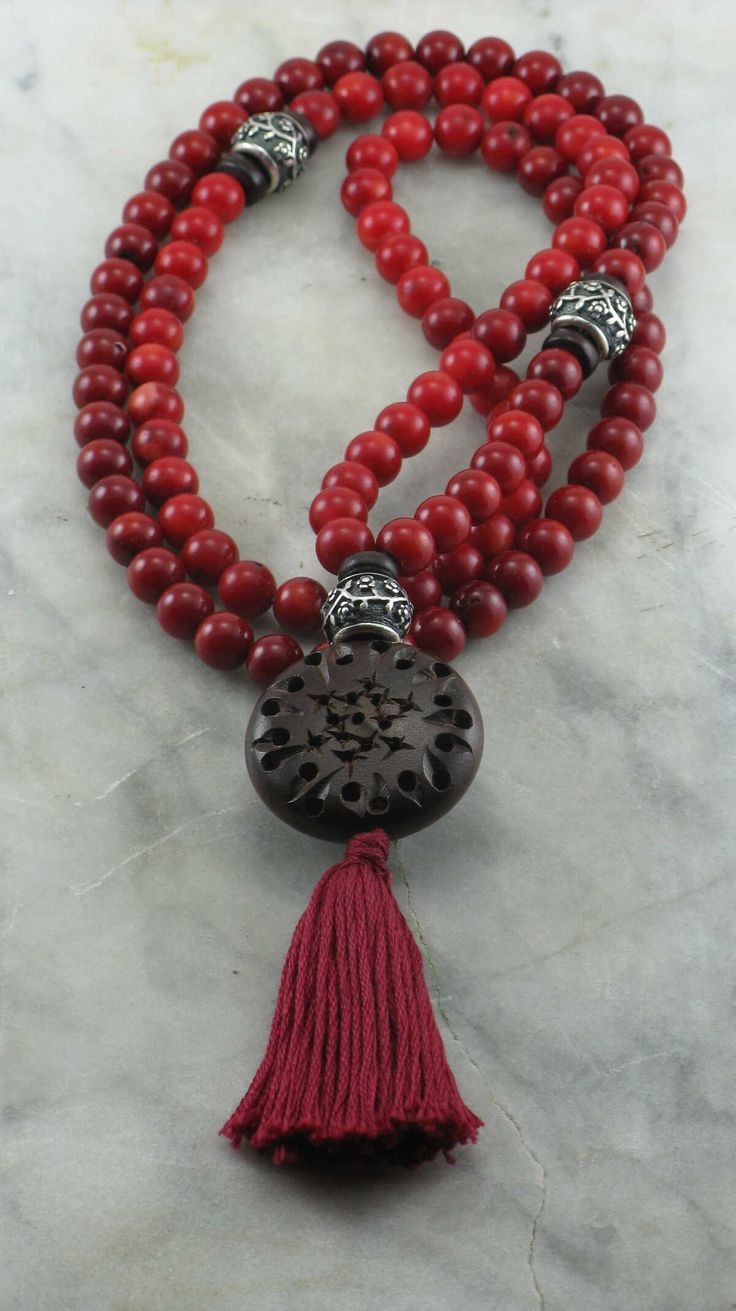 Buddhist prayer beads with 108 coral mala beads and Indian rosewood.