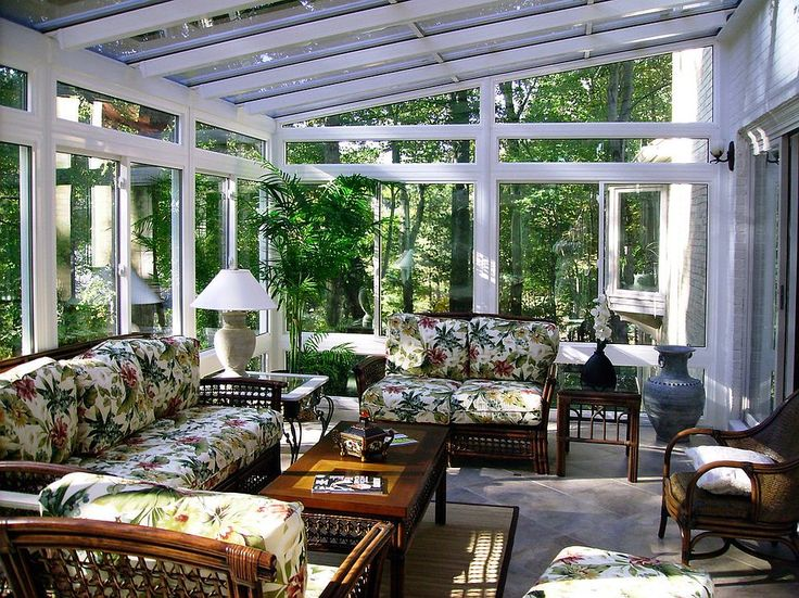 Vibrant seat cushions usher in tropical vibe into this sunroom [Design: Maryland Sunrooms]