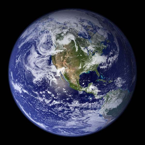 A gorgeous photo of our very own Earth as seen from space with the U.S.A and central America in the center of the photo.