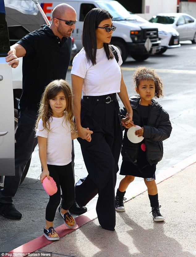 b8f7f512fad4 Doting: Kourtney held hands with daughter Penelope - who she shares with ex  partner Scott .