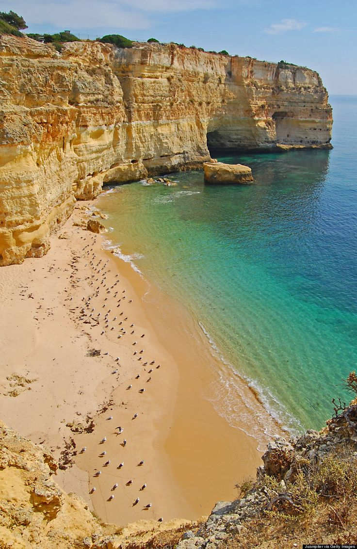 "Marinha Beach Is Clearly One Of The Best Beaches In The World For A Reason | Via The Huffington Post | 14/09/2014 We've seen some ""best beaches"" before, but none has stolen our hearts quite like this. Welcome to Marinha Beach, on the southern coast of Portugal. It's been named one of the best beaches in the world for its stunning natural rock arches and excellent quality of water. #Portugal"