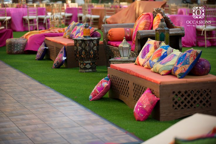 How to perfectly accent outdoor funirture. Love the Indian influence in the choice of colours and patterns.