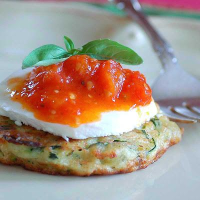 via bklyn contessa :: from savoring time in the kitchen blog :: zucchini fritters + mozzarella + stewed grape tomatoes :: {vegetarian meal idea}