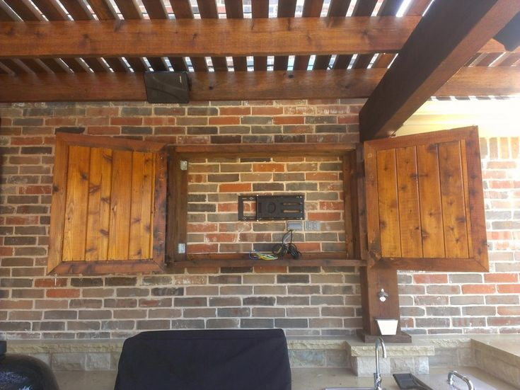 Exterior Furniture. Creative Outdoor TV Cabinet For Entertainment Center Ideas: Awesome Mahogany Unfinished Double Door Outdoor Tv Cabinet Attach At Brick Wall Panels Under Wooden Ceiling Canopy Traditional Outdoor Furnishing Designs