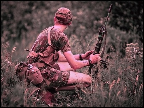 Rhodesian trooper in the bush with his camo painted FN FAL