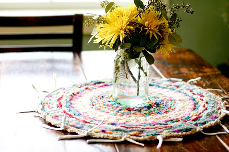 flax & twine: Woven Finger-Knitting Hula-Hoop Rug DIY  I love this as a centerpiece!