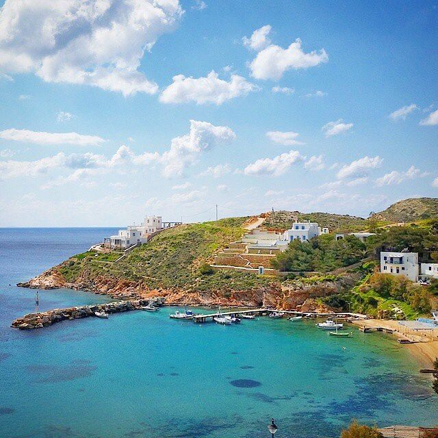 This wonderful place called Achladi beach , at Syros island ( Σύρος ) . Very relaxing bay with smooth sand and crystal clear waters ! You can enjoy your meal at the beautiful taverns by the beach .