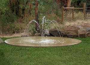 backyard splash pad | The WetDek backyard splash pad is a great complement for existing ...