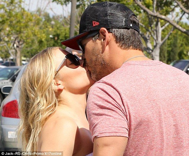 Sealed with a kiss: LeAnn Rimes and husband Eddie Cibrian made a public display of affecti...