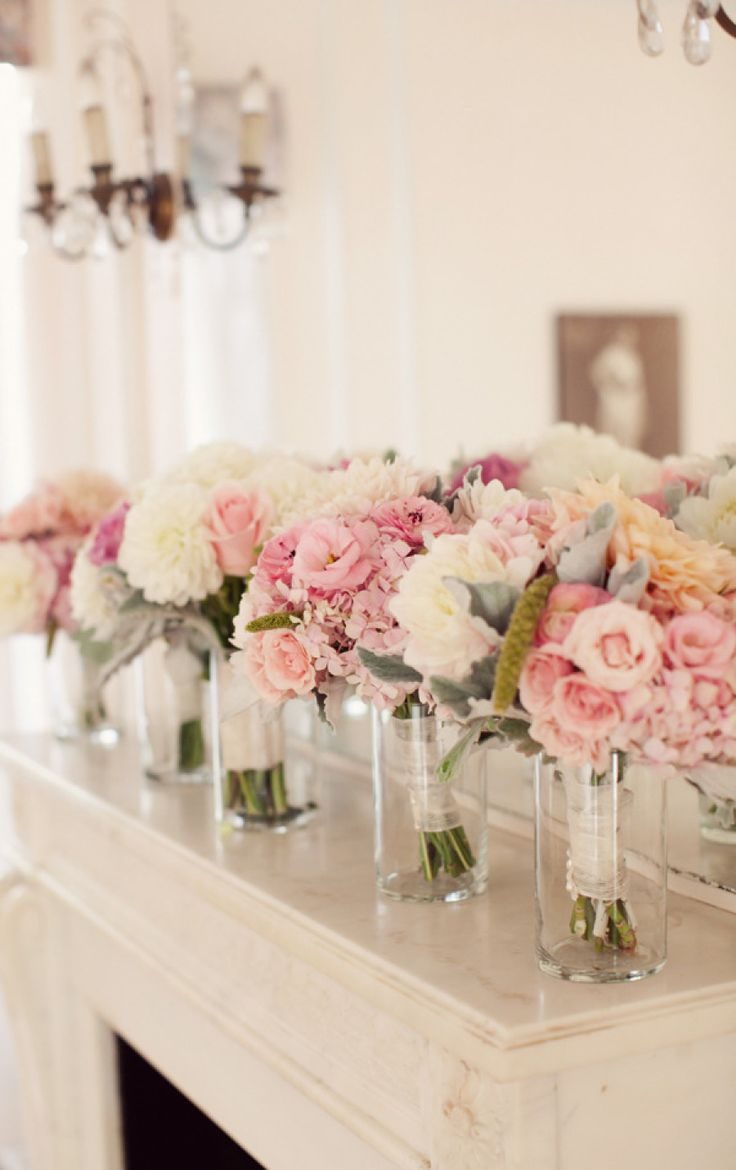 Put bridesmaid bouquets in little vases to make a pretty tablescape at wedding