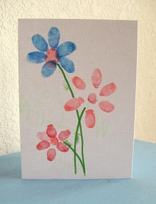 Fingerprint flowers. The boys made cards based on this idea for their grandmas for Mother's Day - they were a big hit!