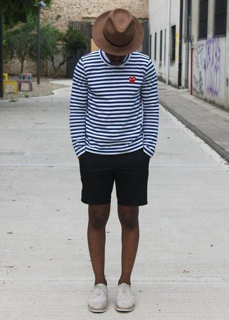Shop this look on Lookastic: https://lookastic.com/men/looks/white-and-navy-long-sleeve-t-shirt-black-shorts-grey-brogues-brown-hat/10428 — Brown Wool Hat — White and Navy Horizontal Striped Long Sleeve T-Shirt — Black Shorts — Grey Suede Brogues