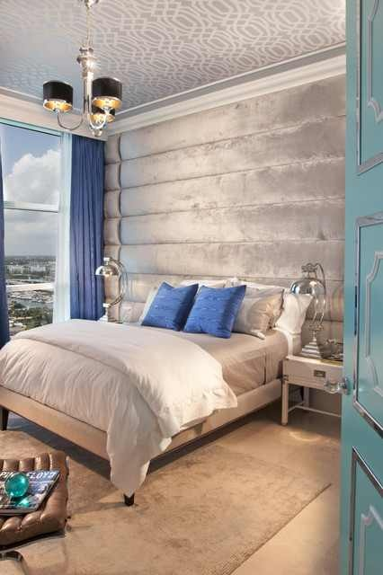 Textured mirrored molding, padded headboard, and the wallpapered ceiling makes this room an oasis!