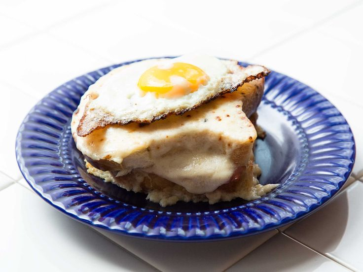 The croque monsieur, the classic French ham and cheese sandwich covered in cheesy bechamel, becomes a madame when a fried egg is placed on top of it.