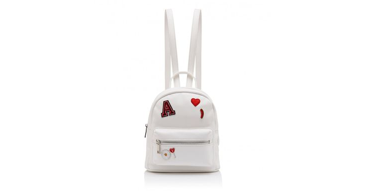For covetable style and timeless elegance, finish your look with our Ashley Pin Badge Mini Backpack