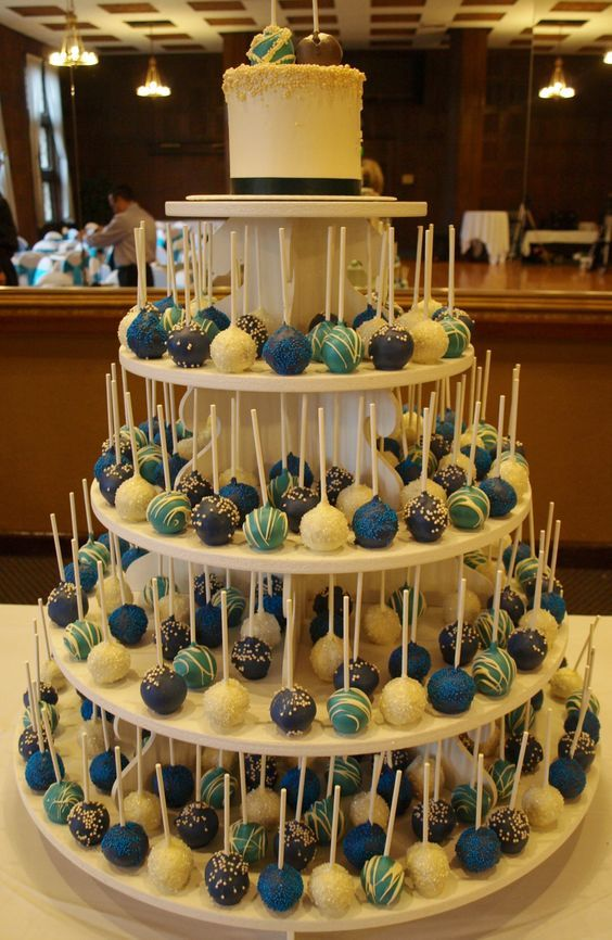 Peacock Colors Wedding Cake Pop Tower... i think i  like this. ... very easy for the guests and me. esp with my messy self and a white dress... so cute!: