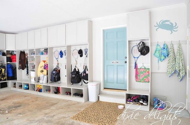 These built in garage lockers to store all of the kids sports gear has me hearing harps! DIY Garage Lockers | Dixie Delights