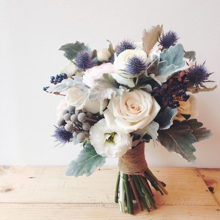 Something different for a bride whose favourite colour is blue - white blush blooms with blue thistles and berries.