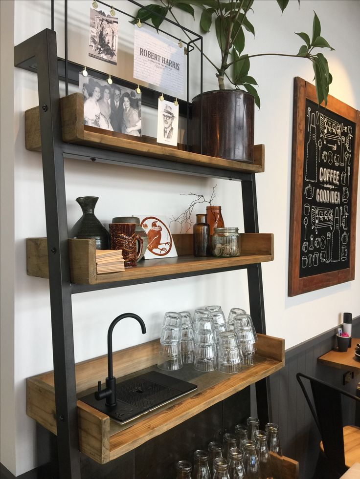 Shelving system for a cafe water station.