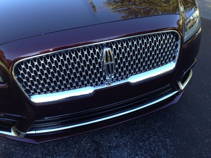 "The Lincoln badge proudly anchored the new grille for the marque, which will be used across all new Lincoln vehicles and replace the ""beak-y"" former design."