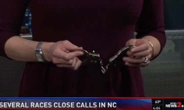 North Carolina News Anchor Grips Handcuffs During Election Polling Segment