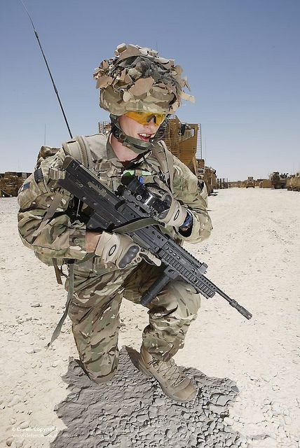 A Signaller with the Royal Signals with a manpack radio, part of the Bowman tactical communications system used by the British Armed Forces, on patrol in Afghanistan.