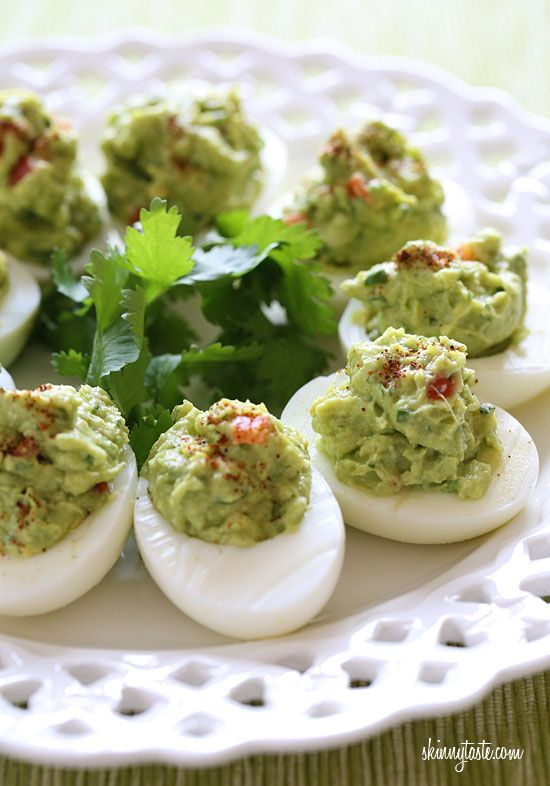 Guacamole Deviled Eggs - If you're looking for a healthy snack of appetizer for St Patrick's Day, these green deviled eggs are the perfect solution.
