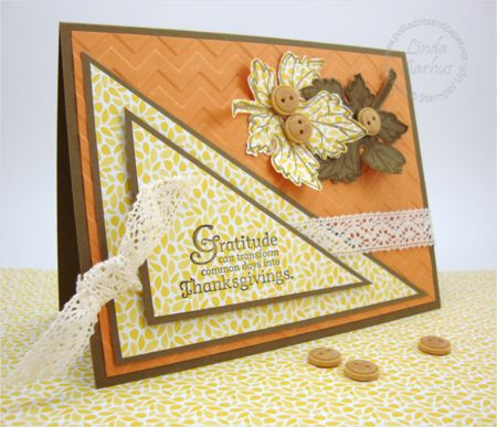 handcrafted Thanksgiving card ... large triangles of matted patterned paper divide the card diagonally ... sentiment on top triangle ... like the stamped and die cut leaves with buttons and the lace ribbon ... like this card!! ... Stampin' Up!