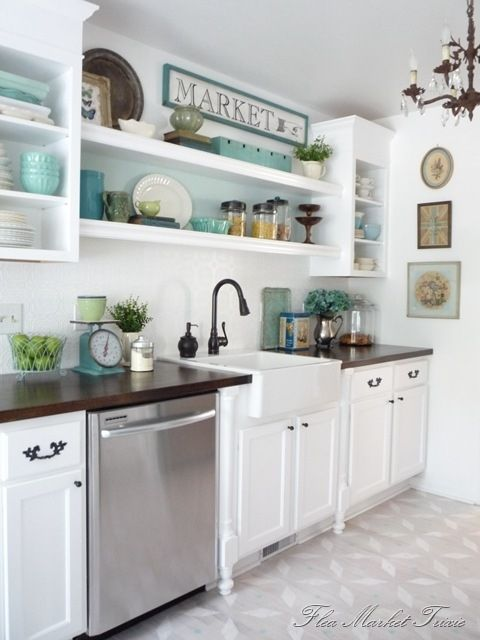 I like the clean lines in the kitchen.  And that you can change up the look of the kitchen by changing small things.  This could easily be a pink, green or orange kitchen by swapping out a few things.