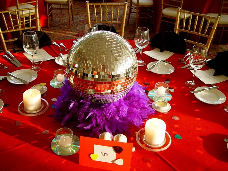 These disco inspired centerpieces are perfect for any for 80 s table decoration ideas