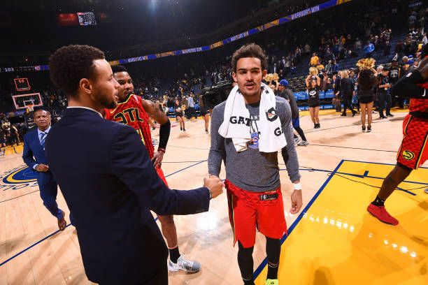 Stephen Curry Of The Golden State Warriors Greets Trae Young
