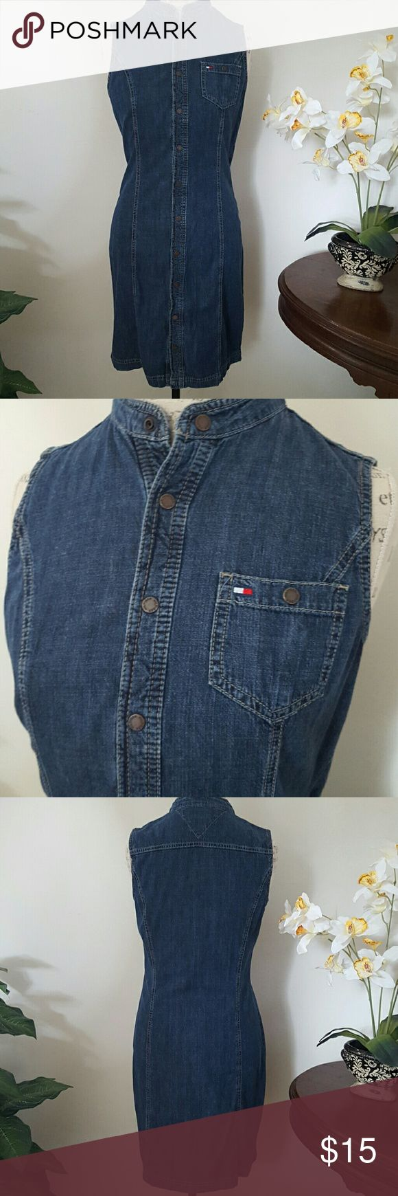 Tommy Hilfiger Jean Dress By Tommy Hilfiger Jeans, made in Turkey.  Snaps all the way down the front for a multitude of looks. Sleeveless with Hilfiger Logo on left breast pocket. Tommy Hilfiger  Dresses Midi