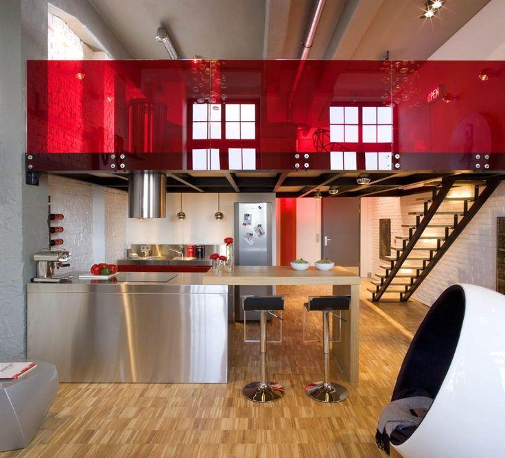 modern inox kitchen with island and red plexiglass
