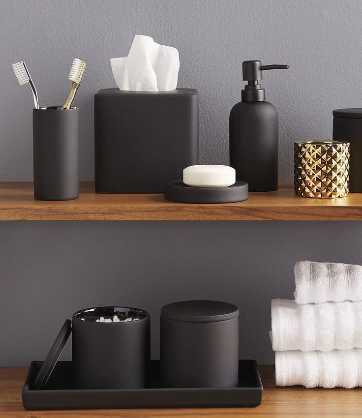 13 Ideas For Creating A Masculine Bathroom // Matte black bathroom accessories add a masculine touch and pack a style punch.