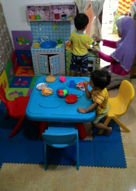 #playing #learning in the #kitchen made from #cardboard #toddleractivity