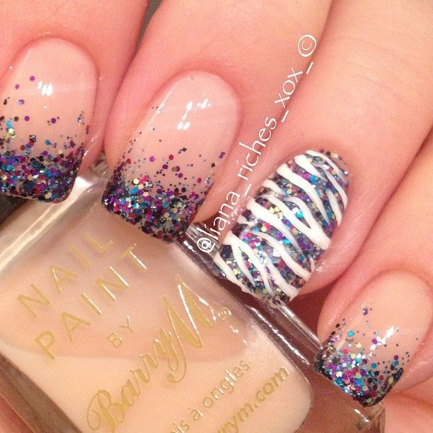 Gorgeous multicoloured sparkle tips with a zebra print accent nail over the same colour as a base #nailart...x