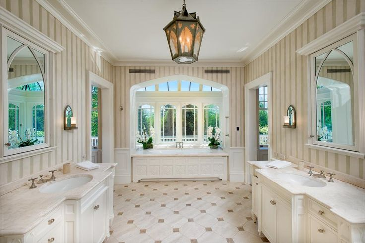 Bathroom of my dreams.  Nestled on almost three acres in picturesque Greenwich, Connecticut, this estate redefines luxury. Built in 1891, the manor features coffered ceilings, detailed millwork and wood-paneled walls throughout. Ornate landscaping and a pool add beauty to the estate grounds.