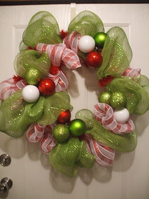 I love this wreath made out of the wide mesh ribbon, a wire wreath and ornaments.
