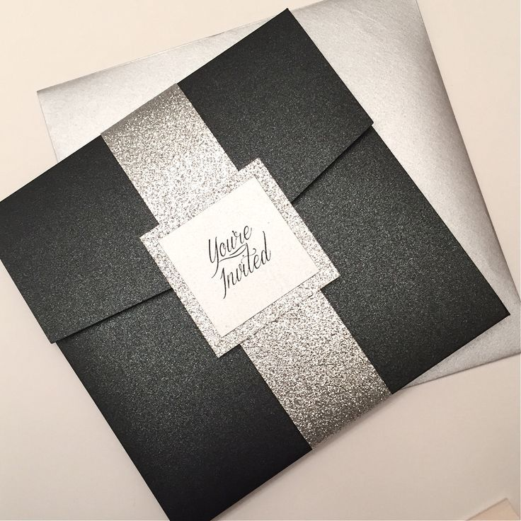 Black and Silver Wedding Invitation, Silver Glitter Pocketfold Invitation,  Black Pocket Wedding Invitation by Lovelytations on Etsy https://www.etsy.com/listing/210912432/black-and-silver-wedding-invitation