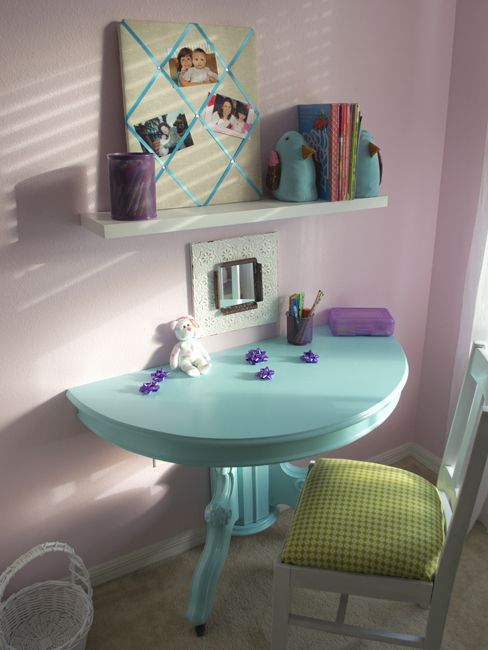 Dont toss out the big round table.  Turn it into a desk.  I'm thinking makeup table for the girls.  I love this idea