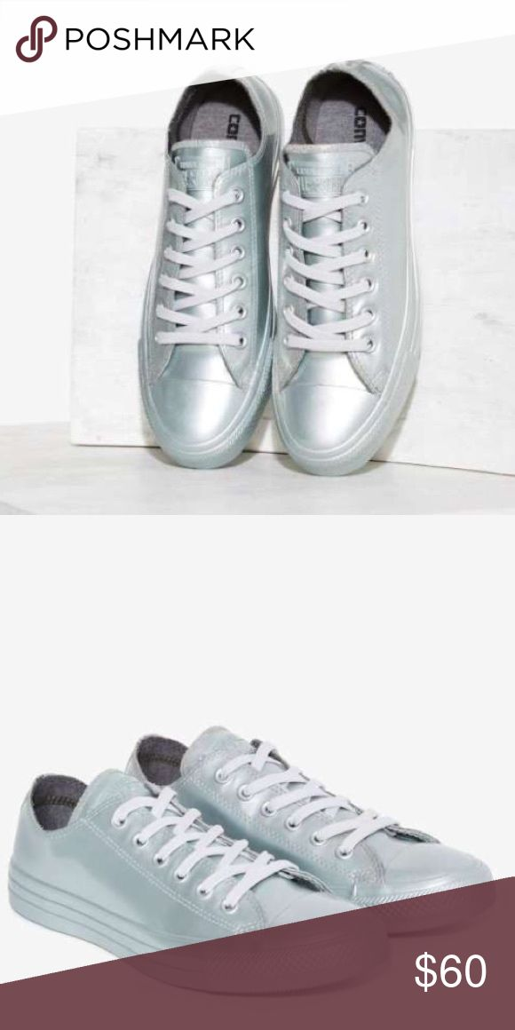 "Converse women's size 8 Metallic shoes This sneaker's the OG–and it just sprang back. The All Star Sneaker is made in metallic silver rubber and features a lace-up front, textured outsole, gray laces, and logo at tongue.  *Rubber  *Shoe height: 3.25""/8.3cm  *Platform height: 1.25""/3.2cm  *Imported Converse Shoes Athletic Shoes"