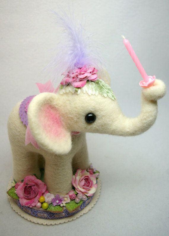 An Original Design This Unique Birthday Cake Topper Features A Cream  Colored Baby Elephant Holding A Single Pink Candle In Her Trunk And