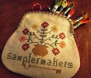 This is a real cute stitched purse for your sewing needs.