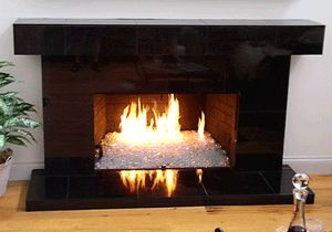 You can convert you old gas fireplace to this.  Replace the faux log with art.   Not too expensive either!